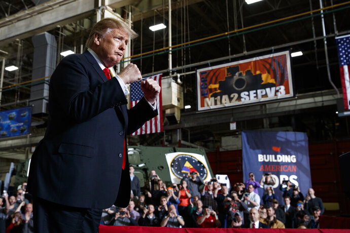 President Donald Trump pumps his fists as he arrives to deliver remarks at the Lima Army Tank Plant, Wednesday, March 20, 2019, in Lima, Ohio. (AP Photo/Evan Vucci)