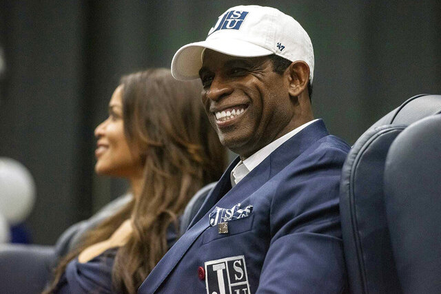 Deion Sanders smiles as he is introduced as Jackson State's head football coach at the Lee E. Williams Athletics and Assembly Center at Jackson State University in Jackson, Miss., Monday, Sept. 21, 2020. (Eric Shelton/The Clarion-Ledger via AP)