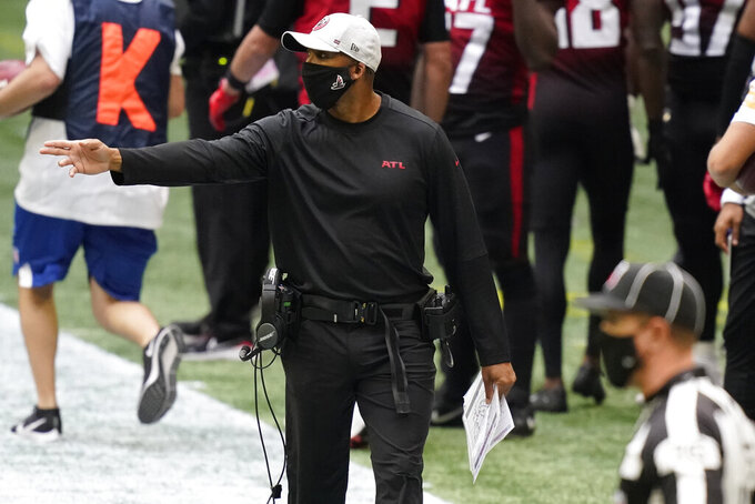 Atlanta Falcons head coach Raheem Morris speaks during the first half of an NFL football game against the Detroit Lions, Sunday, Oct. 25, 2020, in Atlanta. (AP Photo/Brynn Anderson)