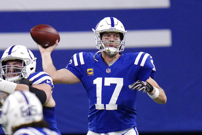 Indianapolis Colts quarterback Philip Rivers (17) looks to throw during the first half of an NFL football game against the Jacksonville Jaguars, Sunday, Jan. 3, 2021, in Indianapolis. (AP Photo/AJ Mast)