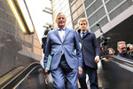 European Union chief Brexit negotiator Michel Barnier, left, rides an escalator on his way to a meeting at the Europa building in Brussels, Friday, Oct. 11, 2019. EU negotiator Michel Barnier says that he had a