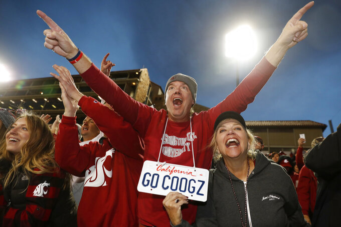 Washington State fans celebrate after an NCAA college football game against Colorado Saturday, Nov. 10, 2018, in Boulder, Colo. Washington State won 31-7. (AP Photo/David Zalubowski)