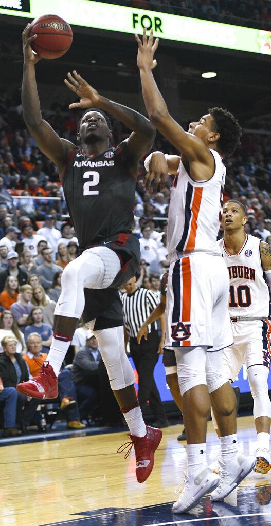 Auburn forward Chuma Okeke (5) defends a shot by Arkansas forward Adrio Bailey (2) during the first half of an NCAA college basketball game Wednesday, Feb. 20, 2019, in Auburn, Ala. (AP Photo/Julie Bennett)