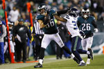 Philadelphia Eagles' Zach Ertz, left, tries to hold off Seattle Seahawks' Quandre Diggs during the second half of an NFL wild-card playoff football game, Sunday, Jan. 5, 2020, in Philadelphia. (AP Photo/Michael Perez)