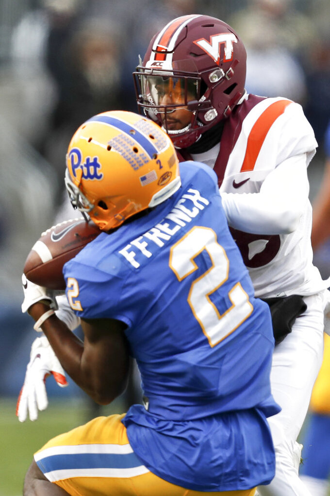 Pittsburgh wide receiver Maurice Ffrench (2) makes a catch as Virginia Tech defensive back Jermaine Waller (28) defends in the second quarter of an NCAA football game, Saturday, Nov. 10, 2018, in Pittsburgh. Ffrench took it in for a touchdown. (AP Photo/Keith Srakocic)