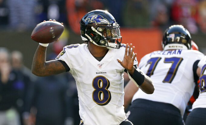 Baltimore Ravens quarterback Lamar Jackson looks to throw against the Cleveland Browns during the first half of an NFL football game, Sunday, Dec. 22, 2019, in Cleveland. (AP Photo/Ron Schwane)