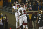 Indiana wide receiver Donavan Hale (6) celebrates a touchdown with teammates wide receiver Ty Fryfogle (3) and running back Ricky Brookins during an NCAA college football game Friday, Oct. 26, 2018, in Minneapolis. Minnesota won 38-31. (AP Photo/Stacy Bengs)