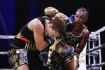 Claressa Shields, right punches Ivana Habazin during the fifth round of a women's 154-pound title boxing bout in Atlantic City, N.J., Friday, Jan. 10, 2020. (AP Photo/Matt Rourke)