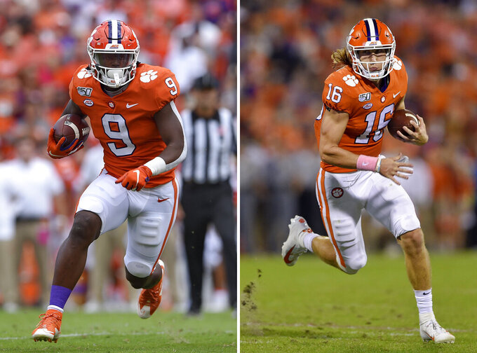 FILE - At left, in a Saturday, Oct. 12, 2019, file photo, Clemson's Travis Etienne runs out of the backfield to score a touchdown during the first half of an NCAA college football game against Florida State, in Clemson, S.C. At right, in a Saturday, Oct. 26, 2019, file photo, Clemson's Trevor Lawrence rushes on a quarterback keeper during the first half of an NCAA college football game against Boston College, in Clemson, S.C. Clemson quarterback Trevor Lawrence and tailback Travis Etienne love competing on the same side with the top-ranked Tigers. If they keep playing as they have, they may be competing against each other for college football's biggest individual prize, the Heisman Trophy. (AP Photo/Richsard Shiro, File)