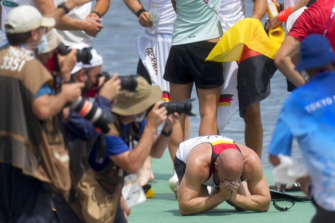 Germany's Ronald Rauhe, reacts after his kayak four 500-meter final team finished first for the gold medal at the 2020 Summer Olympics, Saturday, Aug. 7, 2021, in Tokyo, Japan. (AP Photo/Lee Jin-man)