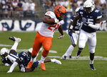 Illinois running back Ra'Von Bonner (21) breaks free of Connecticut linebacker D.J. Morgan (41) and runs in for a touchdown during the first half of an NCAA college football game, Saturday, Sept. 7, 2019, in East Hartford, Conn. (AP Photo/Jessica Hill)
