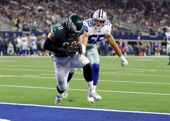 Philadelphia Eagles tight end Dallas Goedert (88) catches a pass for a touchdown in front of Dallas Cowboys outside linebacker Leighton Vander Esch (55) in the first half of an NFL football game in Arlington, Texas, Sunday, Oct. 20, 2019. (AP Photo/Michael Ainsworth)
