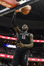 Georgetown center Jessie Govan (15) dunks during the second half of an NCAA college basketball game against Villanova, Wednesday, Feb. 20, 2019, in Washington. Georgetown won 85-73. (AP Photo/Nick Wass)