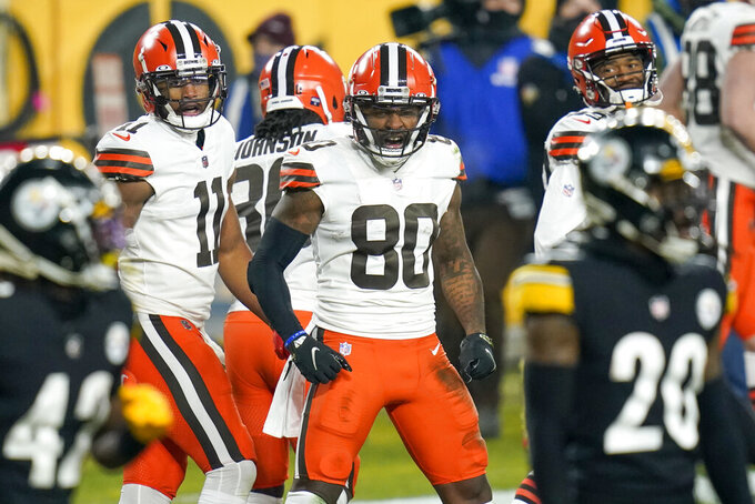 Cleveland Browns wide receiver Jarvis Landry (80) celebrates after scoring on a 40-yard pass play during the first half of an NFL wild-card playoff football game against the Pittsburgh Steelers, Sunday, Jan. 10, 2021, in Pittsburgh. (AP Photo/Keith Srakocic)