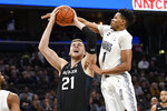 Butler center Derrik Smits (21) is fouled by Georgetown forward Jamorko Pickett (1) during the first half of an NCAA college basketball game, Tuesday, Jan. 28, 2020, in Washington. (AP Photo/Nick Wass)