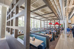 Seating areas at the new Illinois Street Residence Hall dining areas are designed specifically for the restaurants they're situated near, at the University of Illinois, in Urbana, Ill. (Anthony Zilas/The News-Gazette via AP)