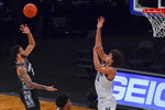 Georgetown guard Jahvon Blair (0) shoots over Villanova forward Jeremiah Robinson-Earl (24) during the second half of an NCAA college basketball game in the quarterfinals of the Big East conference tournament, Thursday, March 11, 2021, in New York. Georgetown won 72-71. (AP Photo/Mary Altaffer)