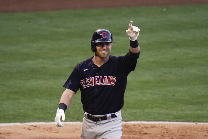 Cleveland Indians' Jake Bauers celebrates his home run during the fifth inning of a baseball game against the Los Angeles Angels, Wednesday, May 19, 2021, in Anaheim, Calif. (AP Photo/Jae C. Hong)