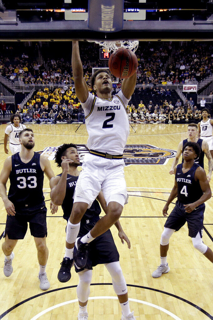 Missouri forward Tray Jackson (2) dunks during the first half of an NCAA college basketball game against Butler, Monday, Nov. 25, 2019, in Kansas City, Mo. (AP Photo/Charlie Riedel)