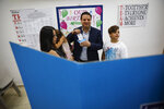 FILE - In this Tuesday, Sept. 17, 2019 file photo, Israeli Arab politician Ayman Odeh casts his vote in Haifa, Israel, Tuesday, Sept. 17, 2019. Israel's Arab coalition appears poised to emerge as the main opposition bloc following Tuesday's vote. The historic first would grant a new platform to a long-marginalized minority and the only major political movement still pushing for peace with the Palestinians. (AP Photo/Ariel Schalit)