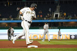 Pittsburgh Pirates' Yoshi Tsutsugo (32) rounds the bases after hitting a solo home run in the seventh inning of a baseball game against the Arizona Diamondbacks, Monday, Aug. 23, 2021, in Pittsburgh. (AP Photo/Keith Srakocic)