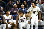 Connecticut's Isaiah Whaley (5), Josh Carlton (25) and Jalen Gaffney (0) cheer for the team during the second half of an NCAA college basketball game against Tulane on Wednesday, Jan. 8, 2020, in Storrs, Conn. (AP Photo/Stephen Dunn)