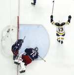 Boston Bruins' Charlie Coyle, right, celebrates a goal against the Columbus Blue Jackets during the third period of Game 6 of an NHL hockey second-round playoff series Monday, May 6, 2019, in Columbus, Ohio. (AP Photo/Jay LaPrete)