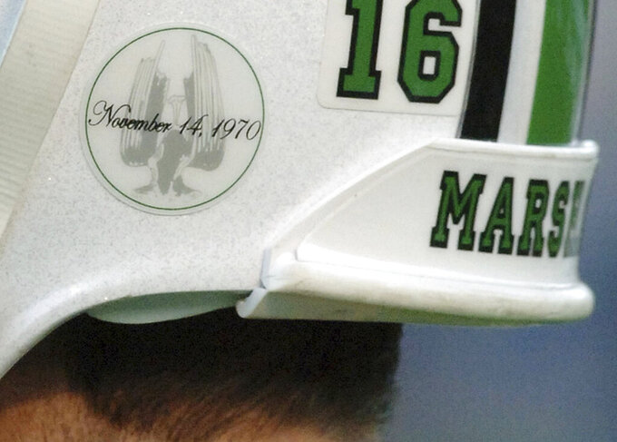 FILE - In this Nov. 19, 2005, file photo, Nov. 19, 2005, a of the Memorial Fountain at Marshall University's student center adorns quarterback Jimmy Skinner's helmet in Huntington, W.Va.  The fountain is dedicated to the memory of 75 people killed in a Nov. 14, 1970, plane crash. Among the victims were 36 Marshall football players. (AP Photo/Jeff Gentner, File)