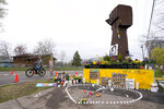A cyclist rolls near a makeshift memorial at the site where Daunte Wright was killed a day after he was laid to rest, Friday, April 23, 2021, in Brooklyn Center, Minn. The 20-year-old Wright was killed by then-Brooklyn Center police officer Kim Potter during a traffic stop. (AP Photo/Julio Cortez)