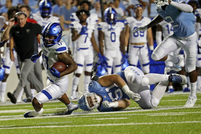Georgia State running back Destin Coates (17) gets tripped up by North Carolina defensive lineman Raymond Vohasek (51) during the first half of an NCAA college football game in Chapel Hill, N.C., Saturday, Sept. 11, 2021. (AP Photo/Chris Seward)