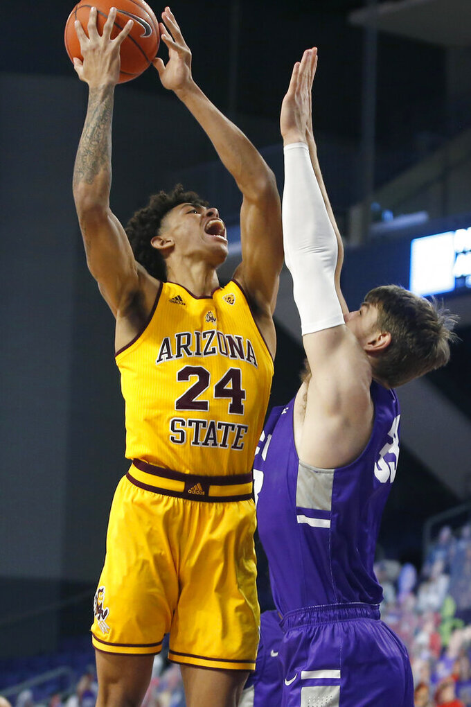 Arizona State forward Jalen Graham (24) shoots over the defense of Grand Canyon center Asbjorn Midtgaard (33) during the first half of an NCAA college basketball game, Sunday, Dec. 13, 2020, in Phoenix. (AP Photo/Ralph Freso)