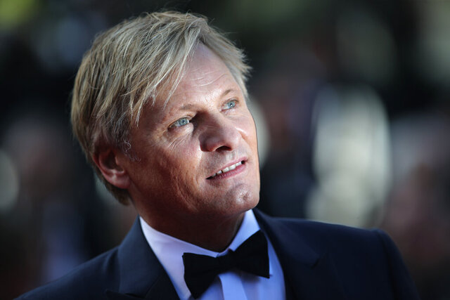 "FILE  - In this Saturday, May 25, 2019 file photo, actor Viggo Mortensen poses for photographers upon arrival at the awards ceremony of the 72nd international film festival, Cannes, southern France. he career of Viggo Mortensen, Aragorn in the popular trilogy ""Lord of the Rings"" and a protagonist in the acclaimed Academy-award winner ""Green Book,"" will be honoured at this year's San Sebastian Film Festival. Mortensen will be also holding the European premiere of ""Falling,"" his directorial debut, at the prestigious festival in northern Spain betwen Sept. 18-26.  (AP Photo/Petros Giannakouris, File)"