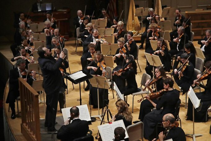 FILE- In this Thursday, Oct. 31, 2019 file photo, Andris Nelsons conducts a joint concert of the Boston Symphony Orchestra and Germany's visiting Leipzig Gewandhaus Orchestra at Symphony Hall in Boston. The BSO said Friday it will open the 2021-2022 season on Sept. 30 after an 18-month live-audience performance hiatus because of the coronavirus pandemic. (AP Photo/Elise Amendola)