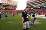 Carolina Panthers quarterback Kyle Allen walks off the field at the end of an NFL football game against the San Francisco 49ers in Santa Clara, Calif., Sunday, Oct. 27, 2019. San Francisco won the game 51-13. (AP Photo/Ben Margot)