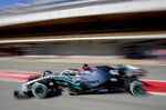 Mercedes driver Lewis Hamilton of Britain drives in the pit lane during the Formula One pre-season testing session at the Barcelona Catalunya racetrack in Montmelo, outside Barcelona, Spain, Wednesday, Feb. 26, 2020. (AP Photo/Joan Monfort)
