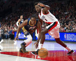 New Orleans Pelicans guard Rajon Rondo, left, and Portland Trail Blazers forward Al-Farouq Aminu chase the ball during the first half in Game 1 of an NBA basketball first-round playoff series Saturday, April 14, 2018, in Portland, Ore. (AP Photo/Randy L. Rasmussen)