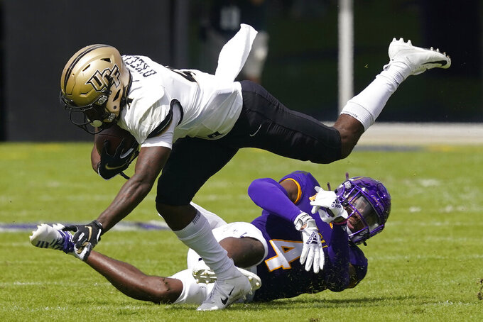 Central Florida wide receiver Ryan O'Keefe (4) runs the ball as East Carolina defensive back Warren Saba (17) tries to make the tackle during the first half of an NCAA college football game in Greenville, N.C., Saturday, Sept. 26, 2020. (AP Photo/Gerry Broome)