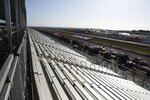 The grandstands are empty overlooking pit lane at the IndyCar Grand Prix of St. Petersburg, Fla., Friday, March 13, 2020 in St. Petersburg, Fla. NASCAR and IndyCar have postponed their weekend schedules at Atlanta Motor Speedway and St. Petersburg, Florida, due to concerns over the COVID-19 pandemic. (Dirk Shadd/Tampa Bay Times via AP)/Tampa Bay Times via AP)