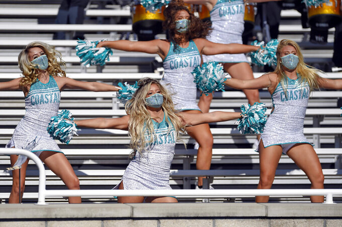 Coastal Carolina cheerleaders perform during the first half of an NCAA college football game against Appalachian State=, Saturday, Nov. 21, 2020, in Conway, S.C. (AP Photo/Richard Shiro)