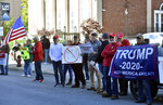 Protesters wait outside of the Scranton Cultural Center for Joe Biden supporters to exit, Wednesday, October 23, 2019 in Scranton, Pa.  (Aimee Dilger/The Times Leader via AP)