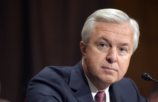 FILE - In this Sept. 20, 2016, file photo, Wells Fargo CEO John Stumpf testifies on Capitol Hill in Washington, before the Senate Banking Committee. Federal regulators have slapped former Wells Fargo Chief Executive Stumpf with a $17.5 million fine for his role in the bank's sales practices scandal. (AP Photo/Susan Walsh, File)