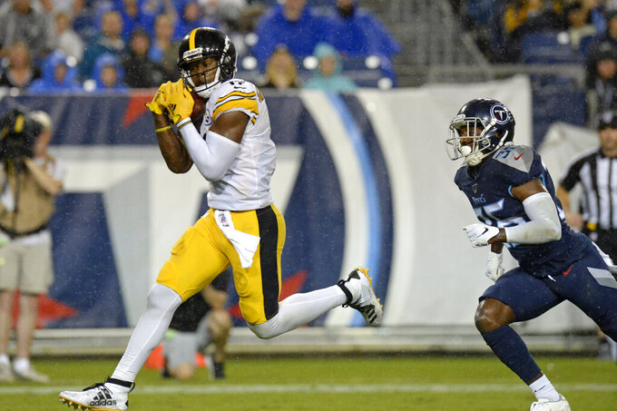 Pittsburgh Steelers wide receiver JuJu Smith-Schuster catches a 17-yard touchdown pass ahead of Tennessee Titans cornerback LeShaun Sims (36) in the first half of a preseason NFL football game Sunday, Aug. 25, 2019, in Nashville, Tenn. (AP Photo/Mark Zaleski)