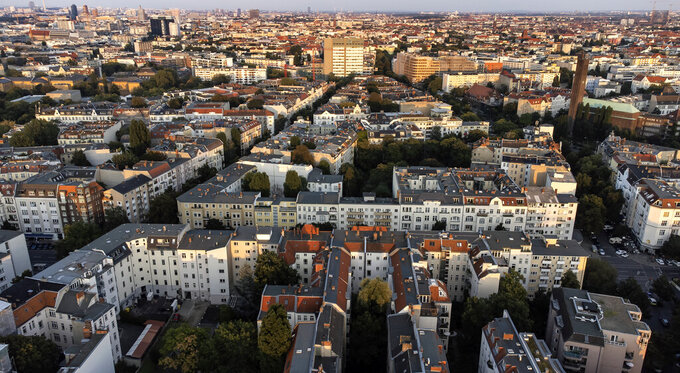 File - This Tuesday, Sept. 7, 2021 file photo, shows the Wilmersdorf district with office buildings and apartment houses in Berlin, Germany. Voters in Berlin backed a non-binding, controversial proposal for the Berlin regional government to take over about 240,000 apartments worth billions from corporate owners to curb sharply rising rents in the German capital. (AP Photo/Michael Sohn, File)