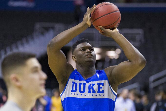 Duke forward Zion Williamson shoots during an NCAA men's college basketball practice in Washington, Thursday, March 28, 2019. Duke plays Virginia Tech in an East Regional semifinal game on Friday. (AP Photo/Alex Brandon)