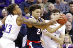 Gonzaga's Anton Watson, center, tries to keep the ball between Washington's Hameir Wright (13) and Sam Timmins in the first half of an NCAA college basketball game Sunday, Dec. 8, 2019, in Seattle. (AP Photo/Elaine Thompson)