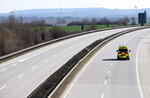 An emergency and rescue car drives on the deserted A4 highway near Erfurt, Germany, Monday, March 23, 2020, the day after the German government spoke out more restrictions to avoid the spread of the novel coronavirus. For most people, the new coronavirus causes only mild or moderate symptoms, such as fever and cough. For some, especially older adults and people with existing health problems, it can cause more severe illness, including pneumonia. (AP Photo/Jens Meyer)