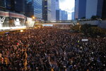 Tens of thousands of protesters march through the streets as they continue to protest an extradition bill, Sunday, June 16, 2019, in Hong Kong. Hong Kong residents Sunday continued their massive protest over an unpopular extradition bill that has highlighted the territory's apprehension about relations with mainland China, a week after the crisis brought as many as 1 million into the streets. (AP Photo/Kin Cheung)