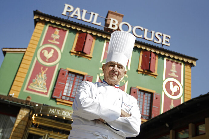 FILE - In this March 24, 2011 file French Chef Paul Bocuse poses outside his famed Michelin three-star restaurant L'Auberge du Pont de Collonges in Collonges-au-Mont-d'or, central France. The restaurant of famous French chef Paul Bocuse, who died two years ago, has lost its third star. It was holding it without interruption since 1965, a world record. (AP Photo/Laurent Cipriani, File)