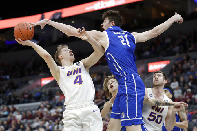 Northern Iowa's AJ Green (4) has his shot blocked by Drake's Liam Robbins (21) during the second half of an NCAA college basketball game in the quarterfinal round of the Missouri Valley Conference men's tournament Friday, March 6, 2020, in St. Louis. (AP Photo/Jeff Roberson)
