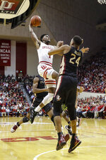 Indiana guard Al Durham (1) goes up for a shot over Florida State guard Devin Vassell (24) during the first half of an NCAA college basketball game Tuesday, Dec. 3, 2019, in Bloomington, Ind. (AP Photo/Darron Cummings)